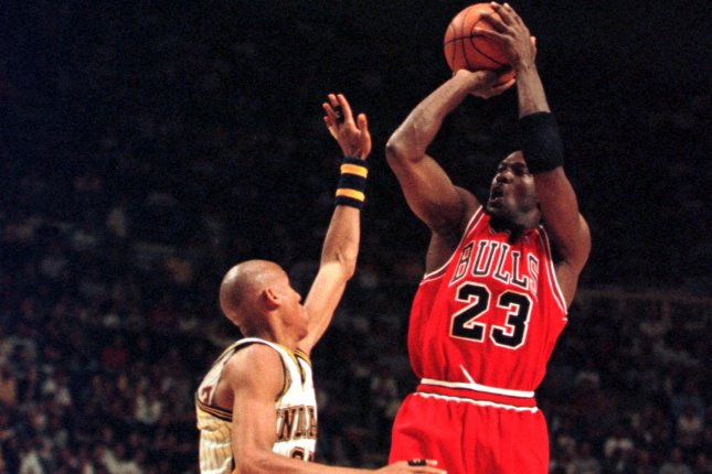 Indiana Pacers legend Reggie Miller (L) thinks his team was better than the Chicago Bulls during the 1998 Eastern Conference finals despite Michael Jordan (R) leading his squad to a sixth title that post-season. File Photo by John Harrell/UPI