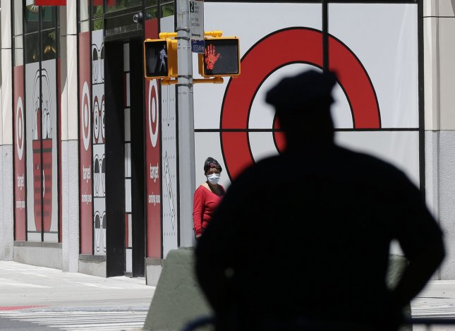 An NYPD Police officer stands by a barricade near a Target retail store as he helps secure the area around Columbus Circle in New York City on June 12. Photo by John Angelillo/UPI