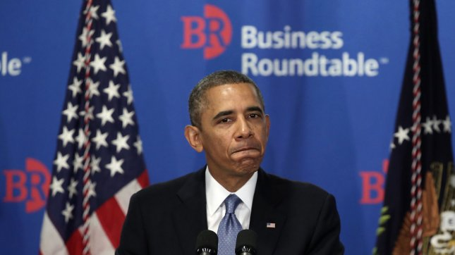 U.S. President Barack Obama pauses as he addresses members of the Business Roundtable on September 18, 2013 at the Business Roundtable Headquarters in Washington, DC. Obama spoke on various topics including the national debt ceiling and immigration reform, and then answered questions from the members after his address. UPI/Alex Wong/Getty/Pool