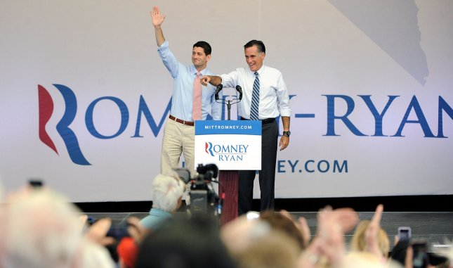Republican presidential nominee Mitt Romney (R) and his running mate Paul Ryan wave to supporters at a campaign event at the Henderson Pavilion in Henderson, Nevada on October 23, 2012. UPI/David Becker