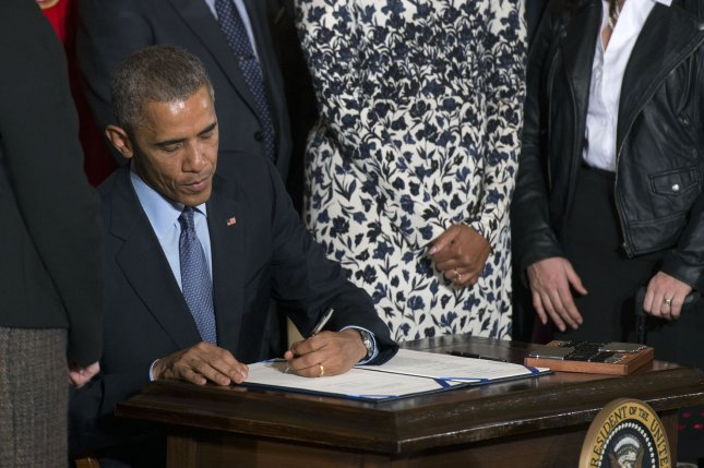 President Barack Obama signs the Clay Hunt Suicide Prevention for American Veterans Act at the White House in Washington, D.C. on February 12, 2015. Photo by Kevin Dietsch/UPI