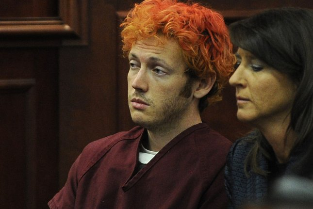 Movie theater shooter James Holmes (left) makes his first court appearance at the Arapahoe County Courthouse with his public defender Tamara Brady on July 23, 2012 in Centennial, Colorado. Holmes was convicted in the death of 12 people. He was assaulted in October 2015 at the Colorado State Penitentiary, but was not injured. UPI/RJ Sangosti/Pool