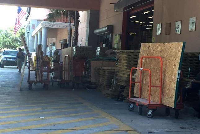 Carts loaded with wood to be used for shutters are stacked up waiting for drivers to load their vehicles from the Home Depot in Delray Beach, Fla., on Tuesday. Residents are preparing for the arrival of Hurricane Irma later this week. Photo by Gary I Rothstein/UPI