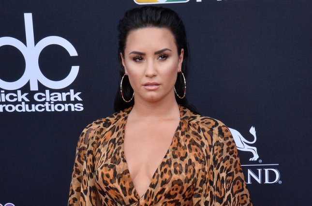 Demi Lovato and Max Ehrich have split, two months after getting engaged during a beachside proposal. File Photo by Jim Ruymen/UPI