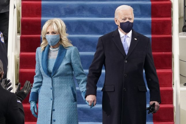 First lady Jill Biden sported a blue tweed dress and coat by Markarian to attend the inauguration of her husband, president Joe Biden. Photo by Patrick Semansky/UPI