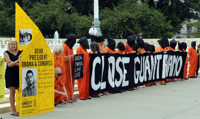 Demonstrators from Amnesty International and Witness Against Torture hold a procession against the use of torture and continued detentions in Guantanamo Bay, Cuba, outside the Supreme Court in Washington, DC, on June 23, 2011. UPI/Roger L. Wollenberg