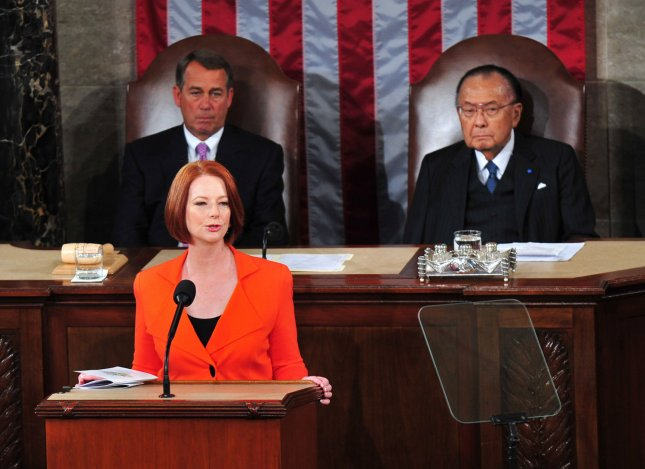 Australian Prime Minister Julia Gillard speaks at a joint session of the U.S. Congress March 9, 2011. House Speaker John Boehner (L) and Sen. Daniel Inouye are seated behind her. UPI/Kevin Dietsch