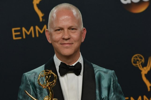 Producer Ryan Murphy appears backstage with his award for Outstanding Limited Series for The People vs. OJ Simpson: American Crime Story during the 68th annual Primetime Emmy Awards on September 18. Murphy said his original comments about how American Horror Story Season 7 would tackle the 2016 presidential election should not be taken literally. File Photo by Christine Chew/UPI