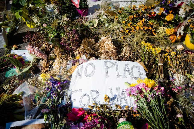Thousands of flowers and messages cover the street in a makeshift memorial at the site where Heather Heyer was killed during a protest in Charlottesville, Va. Photo by Erin Schaff/UPI