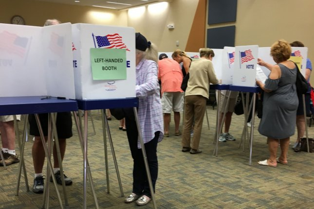 Florida voters cast their ballot at the Hagan Ranch road Public Library, Delray Beach, Fla. on the first day of early voting on Monday. Photo by Gary I Rothstein/UPI