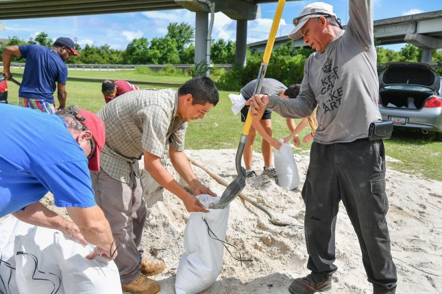 Residents fill sandbags in Mount Pleasant, S.C., Monday in preparation for Hurricane Dorian. Photo by Richard Ellis/UPI