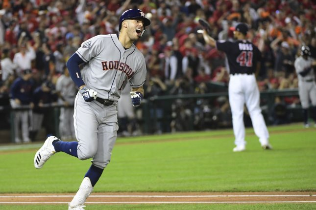 Houston Astros slugger Carlos Correa rounds the bases after hitting a two-run home run in the fourth inning against the Washington Nationals in Game 5 of the 2019 World Series on Sunday at Nationals Park in Washington, D.C. Photo by Kevin Dietsch/UPI