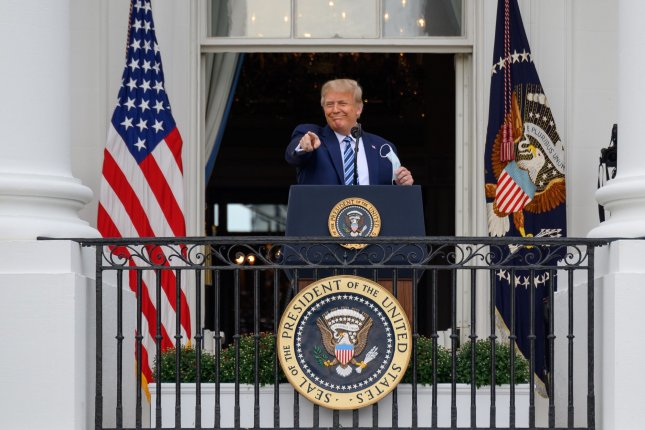 Twitter on Sunday flagged a tweet by President Donald Trump claiming he is now immune to COVID-19 infection after recovering from the virus, saying it violated the platform's rules. Photo by Erin Scott/UPI