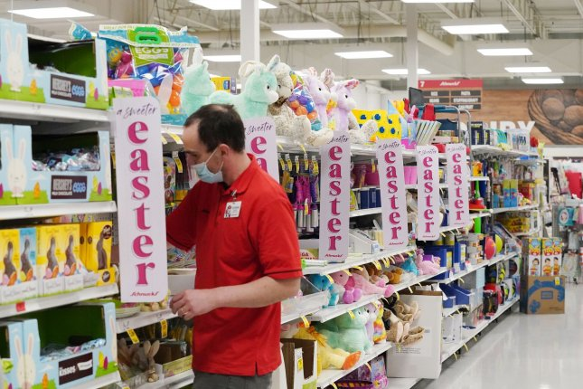 Worker Donnie Myatt refreshes the shelves Tuesday at Schnucks Supermarket in Richmond Heights, Mo. ADP and Moody's said midsize businesses led the way with gains in March, with 188,000 new jobs. Photo by Bill Greenblatt/UPI