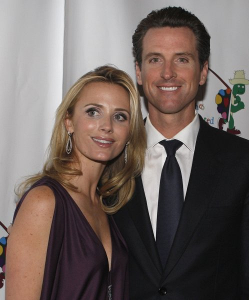 San Francisco Mayor Gavin Newsom and his wife Jennifer Siebel Newsom arrive to host a staged reading of The World of Nick Adams, a performance to benefit Paul Newman's Hole In the Wall California camp, the Painted Turtle, at Davies Symphony Hall in San Francisco on October 27, 2008. (UPI Photo/Terry Schmitt)