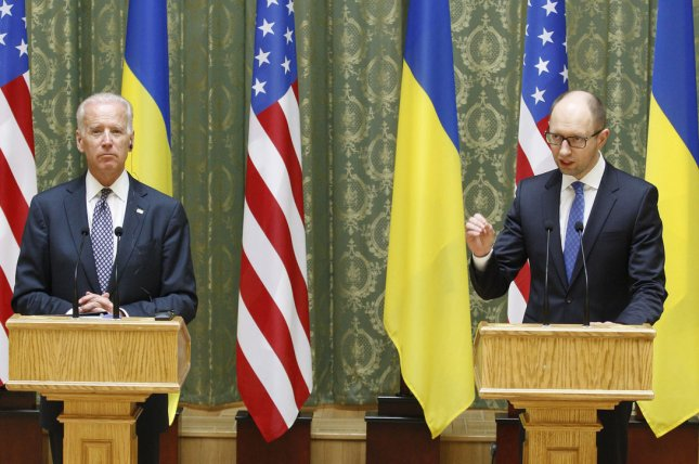 U.S. Vice President Joe Biden (L) and Ukrainian Prime Minister Arseniy Yatsenyuk (R) speak at a joint news conference in Kiev, Ukraine on April 22, 2014. Biden called on Russia to remove troops near the Ukraine border and to live up to its commitment to defuse the situation in eastern Ukraine. (UPI/Ivan Vakolenko)