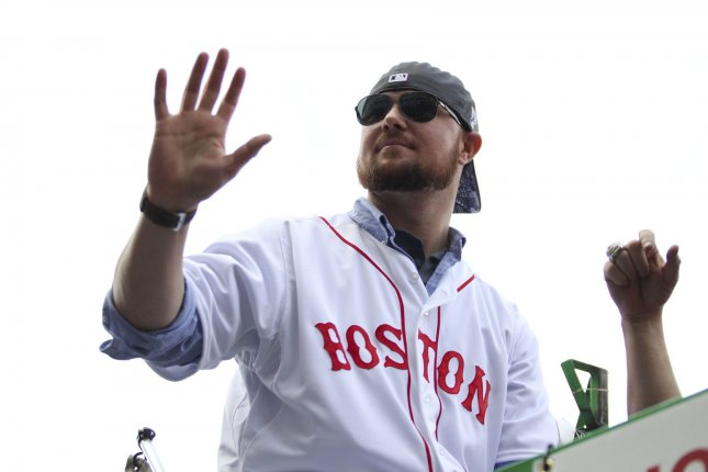 Boston Red Sox pitcher Jon Lester waves to the crowd during a rolling rally parade for the 2013 World Series Champions in Boston on November 2, 2013. UPI/Matthew Healey