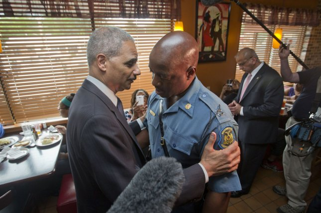Attorney General Eric Holder, left, with Capt. Ron Johnson of the Missouri State Highway Patrol visited Ferguson. Mo., on Aug. 20. 2014. after Michael Brown was shot by a local police officer. UPI/Pablo Martinez Monsivais/Pool