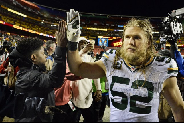 36ca30450 Green Bay Packers inside linebacker Clay Matthews (52) gets a high-five  after defeating the Washington Redskins 35-18 in their NFC Wild Card game  at FedEx ...