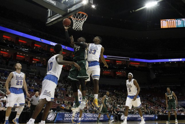 UAB Blazers' Tosin Mehinti (21) fights to get his shot off under pressure from UCLA Bruins' Tony Parker (23) during the first half of play in their third round game of the 2015 NCAA Division I Men's Basketball Championship at the KFC Yum! Center in Louisville, Kentucky, March 21, 2015. Photo by John Sommers II/UPI