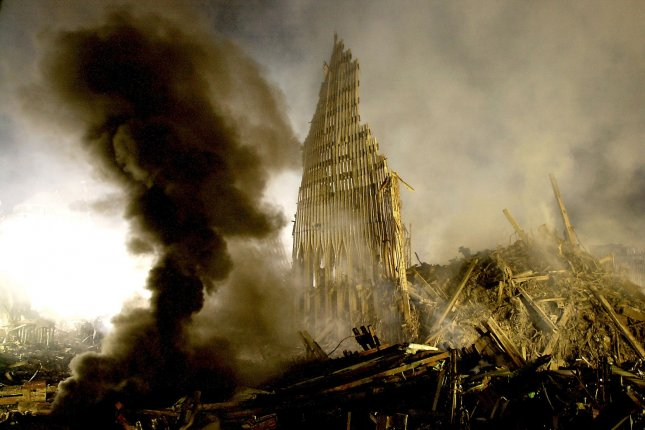 A cloud of smoke rises from a fuel tank fire in an area called Ground Zero in New York City as tons of wreckage still remain, including a partial standing wall of the World Trade Center, September 17, 2001, one week after the devastating attack by outside terrorists. Photo by Chris Corder/UPI