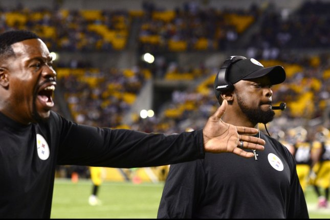 Pittsburgh Steelers head coach Mike Tomlin reacts to the penalty call as Steelers outside linebacker coach Joey Port yells at the official in the fourth quarter of the New England Patriots 37-26 win at Heinz Field in Pittsburgh on October 23, 2016. Photo by Archie Carpenter/UPI