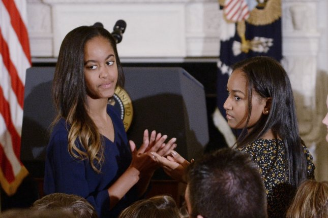 Malia Obama (L) and sister Sasha Obama at outgoing vice president Joe Biden's Medal of Freedom ceremony on January 12. File Photo by Olivier Douliery/UPI