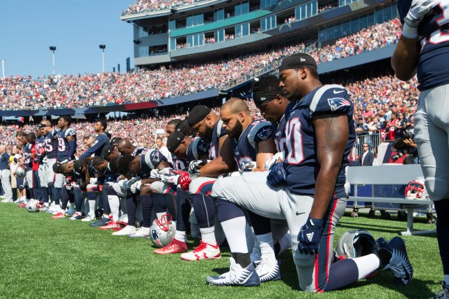 Numerous New England Patriots players take a knee during the national anthem prior to the game against the Houston Texans Sunday at Gillette Stadium in Foxborough, Mass. Photo by Matthew Healey/UPI