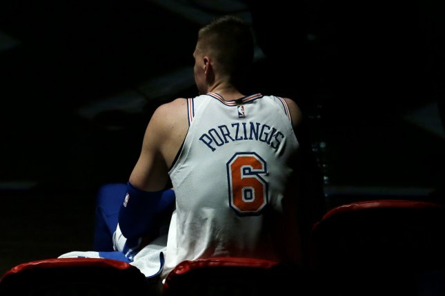 New York Knicks forward Kristaps Porzingis sits on the bench when a time out is called in the first half against the Portland Trailblazers on November 27, 2017 at Madison Square Garden in New York City. File photo by John Angelillo/UPI