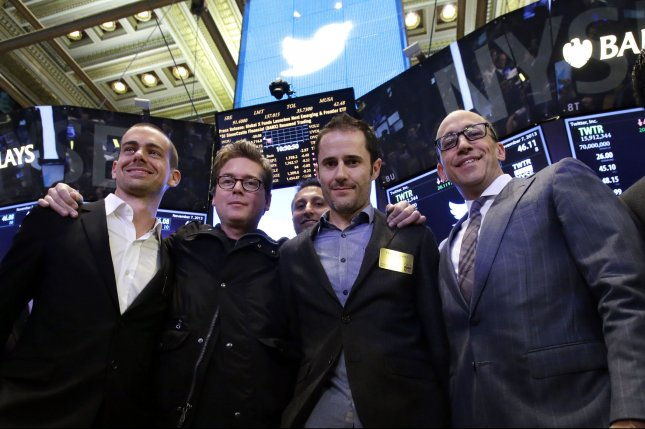 Twitter co-founder Jack Dorsey, at left, stands with others on the floor of the New York Stock Exchange upon the company's initial public offering in 2013. Dorsey said Tuesday Twitter has not banned controversial commentator Alex Jones because none of his posts have broken platform rules. File Photo by John Angelillo/UPI