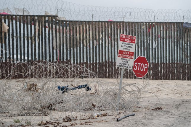 North Dakota-based Fisher Sand & Gravel has received a $400 million contract to construct a 31-mile section along the U.S.-Mexico border in Arizona. A section of border fence is pictured in June on the beach at International Friendship Park in Imperial Beach, California. File Photo by Kevin Dietsch/UPI