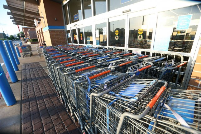 Shopping carts block the entrance to a Walmart store in Brentwood, Mo., on June 4, after a protest against the killing of George Floyd. Walmart this week pulled guns from its sales floors in response to looting at a store in Philadelphia, but reversed the decision after one day. File Photo by Bill Greenblatt/UPI