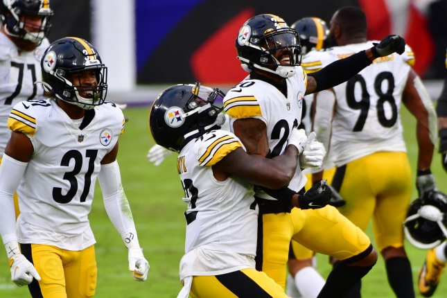 Pittsburgh Steelers linebacker Ola Adeniyi (92) and cornerback Cameron Sutton (20) celebrate a fumble recovery during the second half Sunday afternoon at M&T Bank Stadium in Baltimore. Photo by David Tulis/UPI