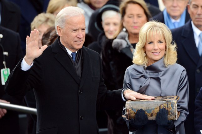 Joe Biden is sworn in as vice president on January 21, 2013. There may be fewer people at his presidential inauguration ceremony on January 20, 2021, after his inaugural team asked people to watch the ceremony from home. File Photo by Kevin Dietsch/UPI