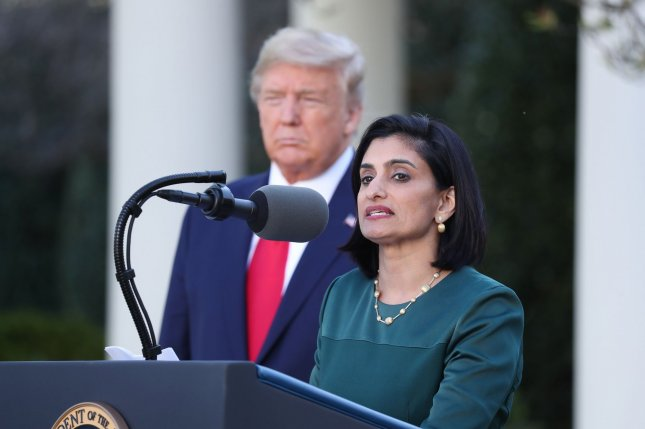Centers for Medicare and Medicaid Services Administrator Seema Verma speaks at the White House in March 2020 as President Donald Trump looks on. In January, Verma said the rule change would remove government barriers to helpful medical technologies for seniors. File Photo by Michael Reynolds/UPI