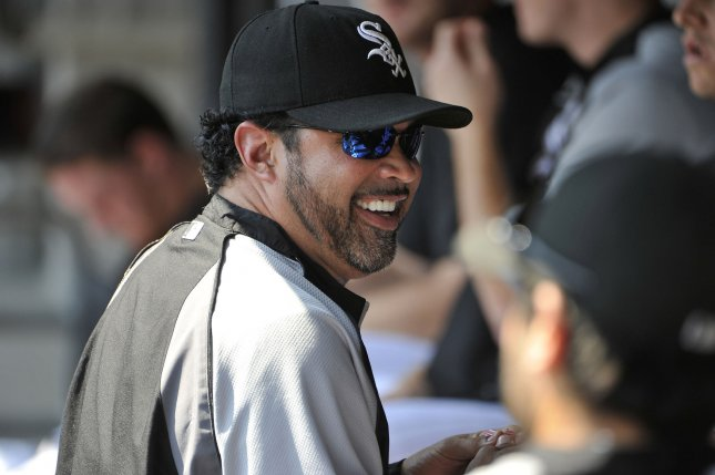Former Chicago White Sox manager Ozzie Guillen smiles as he stands in the dugout against the Minnesota Twins at U.S. Cellular Field on August 31, 2011 in Chicago. The Twins won 7-6. UPI/Brian Kersey