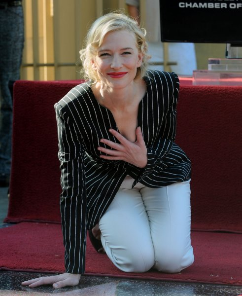 Australian actress Cate Blanchett kneels after she received a star on the Hollywood Walk of Fame during an unveiling ceremony in Los Angeles on December 5, 2008. Blanchett was the 2,376th celebrity to be honored with a star on the Walk of Fame. (UPI Photo/Jim Ruymen)