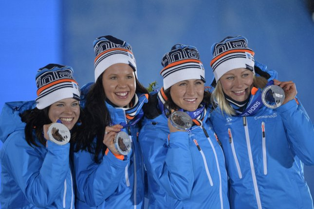 Finland's Anne Kylloenen (R-L), Aino-Kaisa Saarined, Kerttu Niskanen and Krista Lahteenmaki, hold up their silver medals during the victory ceremony for the cross-country skiing ladies' 4 X 5km relay at the Sochi 2014 Winter Olympics on February 16, 2014 in Sochi, Russia. UPI/Brian Kersey