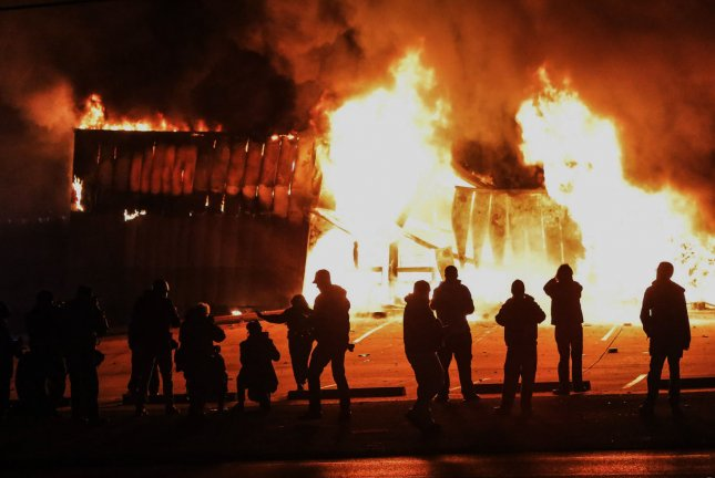 The downtown section of Ferguson, Missouri, burns during the night of Nov. 24-25 after a grand jury decided not to indict police officer Darren Wilson in the killing of Michael Brown. File Photo by Lawrence Bryant/UPI