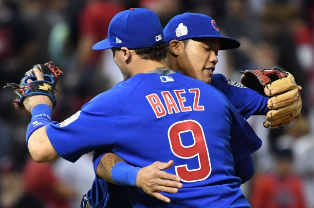 Chicago Cubs shortstop Addison Russell (R) hugs second baseman Javier Baez after beating the Cleveland Indians in game 6 of the World Series at Progressive Field in Cleveland, Ohio on November 1, 2016. Chicago ties the series at 3-3 defeating Cleveland 9-3. Photo by Pat Benic/UPI
