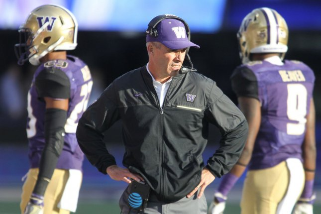 Washington Huskies head coach Chris Petersen surveys the field as his defensive unit heads to the sidelines against Oregon State Beavers in the second quarter at Husky Stadium October 22, 2016 in Seattle. The Huskies beat the Beavers 41-17. Photo by Jim Bryant/UPI