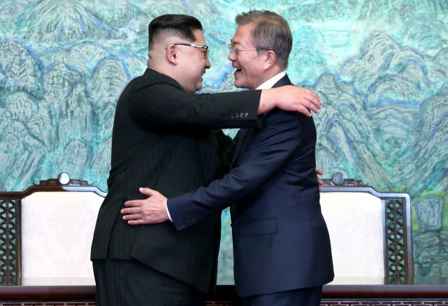 South Korean President Moon Jae-in (R) and North Korean Chairman of the State Affairs Committee Kim Jong Un share a hug after signing the joint Panmunjom Declaration at the Peace House in the border village of Panmunjom in Paju, South Korea, on April 27, 2018. It was the first time a North Korean leader had crossed the border since the Korean War. Photo by Inter-Korean Summit Press Corps/UPI