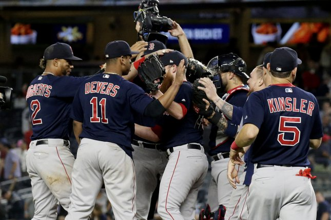 Boston Red Sox players celebrate after a game against the New York Yankees on Thursday at Yankee Stadium in New York City. Photo by John Angelillo/UPI