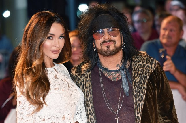 Nikki Sixx (R) and Courtney Sixx are expecting their first child together. File Photo by Christine Chew/UPI