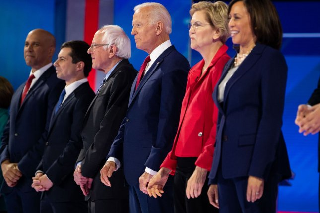 Democratic presidential candidates, from left to right, New Jersey Sen. Cory Booker, South Bend (Ind.) Mayor Pete Buttigieg, Vermont Sen. Bernie Sanders, former Vice President Joe Biden, Massachusetts Sen. Elizabeth Warren and California Sen. Kamala Harris are introduced Thursday night prior to the debate at Texas Southern University in Houston. Photo by Kevin Dietsch/UPI