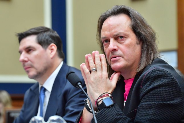 T-Mobile CEO John Legere (R) testifies on February 13 before a House committee over his company's $26 billion merger with Sprint, on Capitol Hill in Washington, D.C. File Photo by Kevin Dietsch/UPI