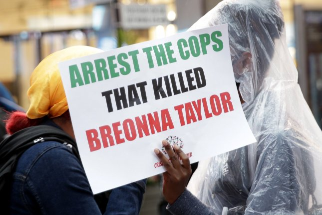 An activist holds a sign calling for justice in the March police killing of Breonna Taylor, in New York City's Times Square during a civil rights demonstration on July 31. Photo by John Angelillo/UPI