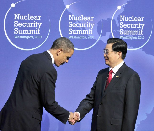 United States President Barack Obama welcomes President Hu Jintao of China to the Nuclear Security Summit at the Washington Convention Center, Monday, April 12, 2010 in Washington, DC. UPI/Ron Sachs/Pool