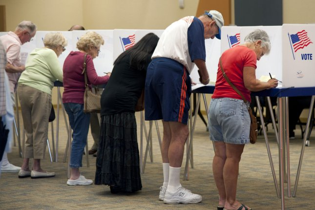 Florida voters cast their ballots in the 2012 Election at the public library in Delray Beach, Florida, November 6, 2012. The Florida polls are open from 7a.m. to 7p.m. UPI/Gary I Rothstein