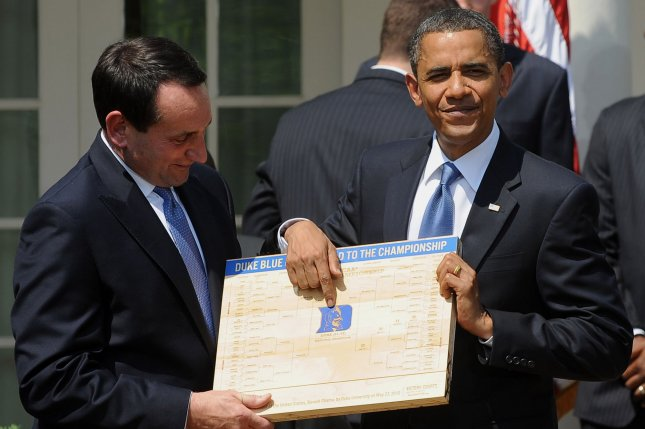 U.S. President Barack Obama accepts a Duke Blue Devils' Road to the Championship plaque, made from the basketball court, from Head Coach Mike Krzyzewski as he hosts the 2010 NCAA College Basketball Champion Duke Blue Devils in the Rose Garden of the White House in Washington on May 27, 2010. UPI/Roger L. Wollenberg